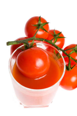bunch of tomatoes and glass of tomato juice photo