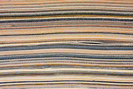 Macro closeup of pages in stack magazine, cardboard or cardstock. photo