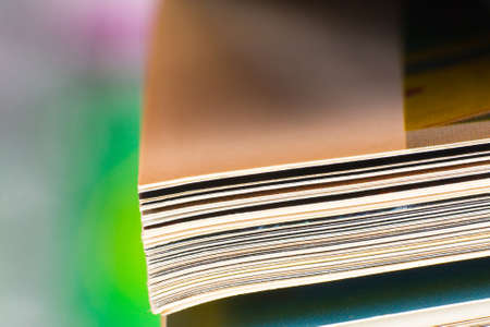 Close-up of magazine pages. Shallow DOF, focus on edges.  photo