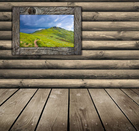 Mountain landscape on old wooden wall photo
