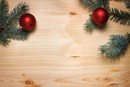 Christmas fir tree with decoration on a wooden board  photo