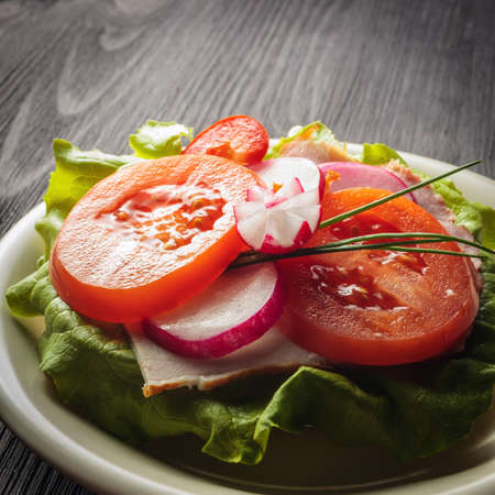 salad with red and yellow peppers and lettuce, food  photo
