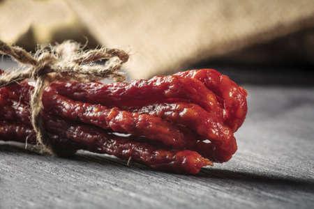 schein: dried sausages on wooden cutting board