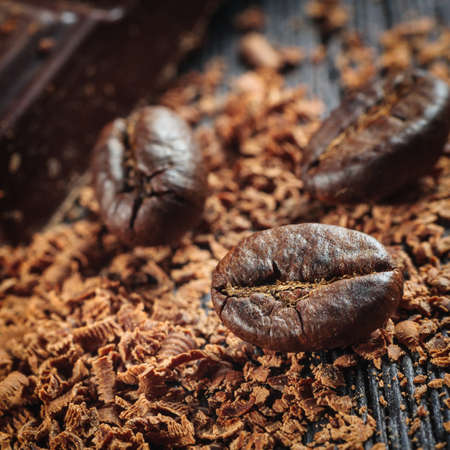 Fresh roasted coffee beans and stack of brown chocolate Stock Photo - 24293204