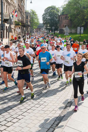 cracovia: KRAKOW, POLAND - MAY 18 : Cracovia Marathon. Runners on the city streets on May 18, 2014 in Krakow, POLAND