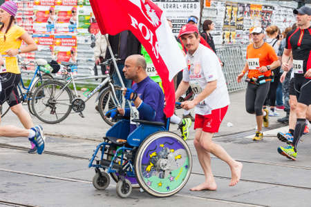 cracovia: KRAKOW, POLAND - MAY 28 : Cracovia Marathon. Unidentified handicapped man in  marathon on a wheelchair on the city streets on May 18, 2014 in Krakow, POLAND