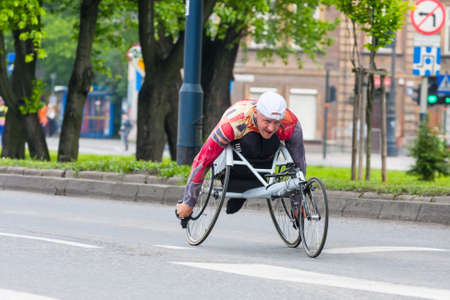 cracovia: KRAKOW, POLAND - MAY 28   Cracovia Marathon  Unidentified handicapped man in  marathon on a wheelchair on the city streets on May 18, 2014 in Krakow, POLAND