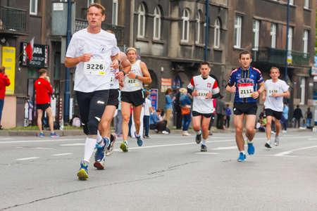 cracovia: KRAKOW, POLAND - MAY 18   Cracovia Marathon  Runners on the city streets on May 18, 2014 in Krakow, POLAND