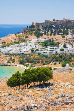 Lindos, castle above on the Greek Island of Rhodes  photo