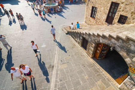 hippocrates: RHODES, GREECE - JUNE 23: Unidentified tourists walking in historic centre of Rhodes on June 23, 2008. Rhodes is most popular turist destination located in the eastern Aegean Sea.  Editorial