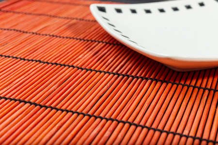 Plate on bamboo mat photo