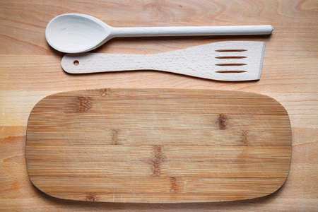wooden cutlery on cutting board photo