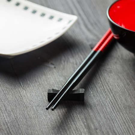 Two chopsticks on sushi mat background photo