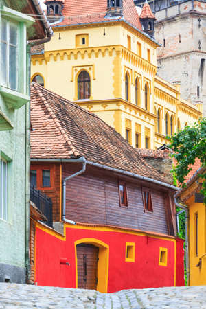 Medieval street view in Sighisoara founded by saxon colonists in XIII century, Romania photo