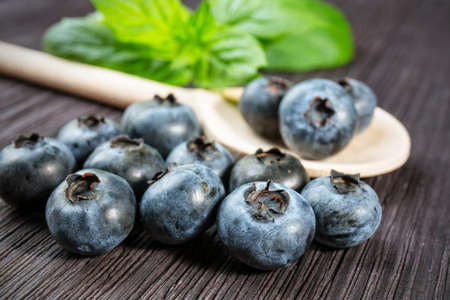 Blueberry on wooden board photo