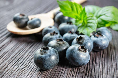 Blueberries on wooden board photo