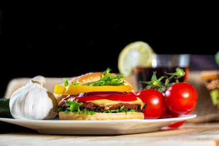 hamburger and drink with slice of lemon  photo