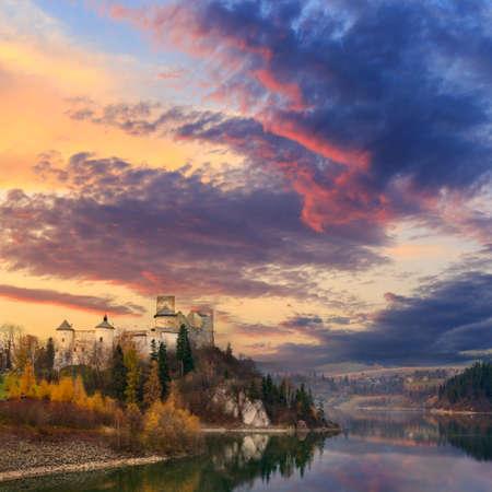Beautiful dramatic sky over old castle Standard-Bild