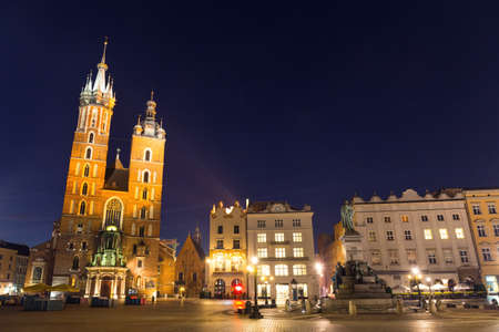 St. Marys Church in Market Square, Krakow, Poland. photo