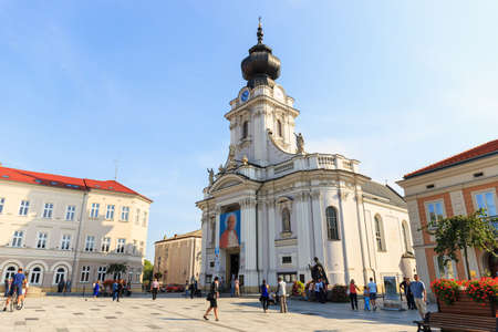 Wadowice, Poland - September 07, 2014: Tourists visit the city center of Wadowice. Wadowice is the place of birth of Pope John Paul II