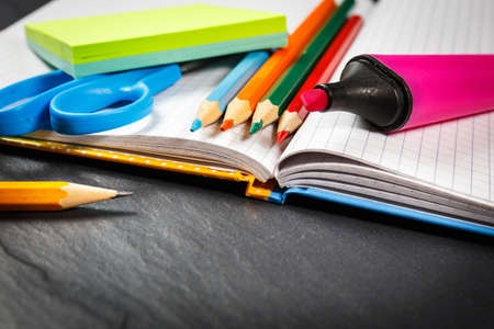 School supplies on black background photo