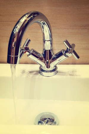 water tap with modern design in bathroom, vintage look photo