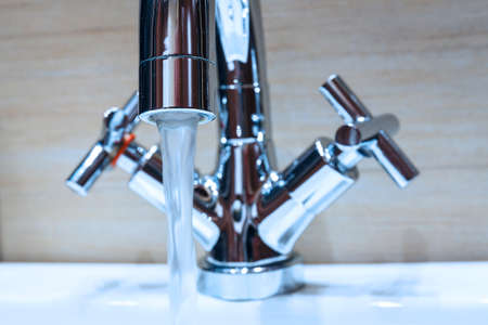 water tap with modern design in bathroom photo