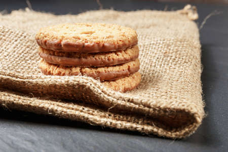 Closeup of stack biscuit cookies on table photo