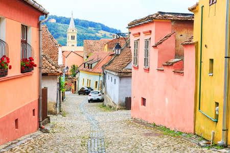 Medieval street view in Sighisoara founded by saxon colonists in XIII century, Romania Zdjęcie Seryjne