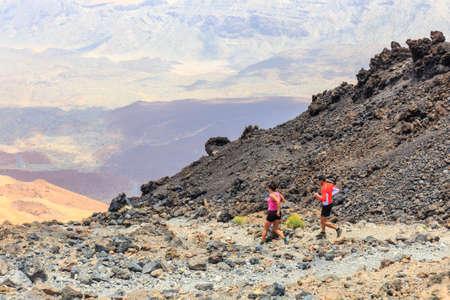 El Teide, Tenerife, June 06, 2015: Unidentified people runs from the top of El Teide Volcano, Tenerife, Spain