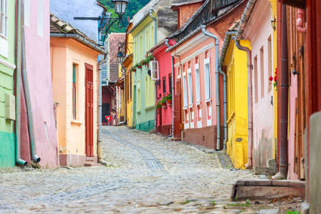 Medieval street view in Sighisoara founded by saxon colonists in XIII century, Romania Stock Photo