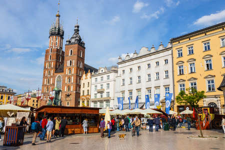 main market: KRAKOW, POLAND - May 15 2015: Unidentified tourists visiting main market square in Krakow, Poland Editorial