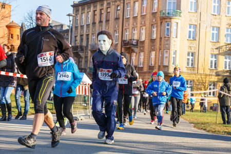 december 31: Krakow, Poland - December 31, 2015: 12th New Years Eve Race in Krakow. The people running dressed in funny costumes