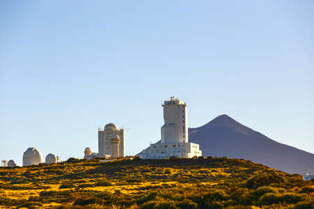 stratovolcano: Telescopes of the Astronomical Observatory Izana with Volcano El Teide in the background, Spain Editorial