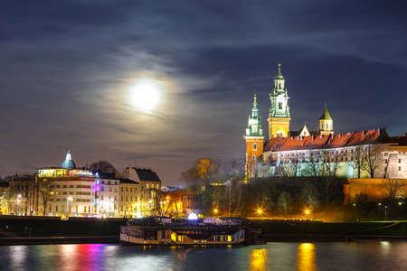wawel: Full moon over Wawel Castle in the night in Krakow, Poland