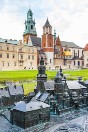 braille: Model of the Royal Castle in Krakow with real buildings in the background, Braille system