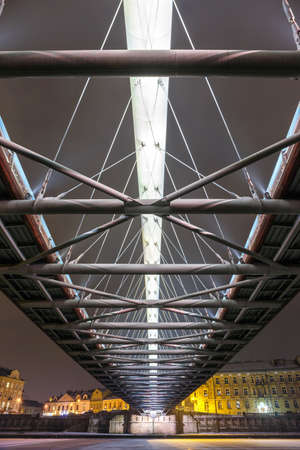 superstructure: Bernatka footbridge over Vistula river in the night in Krakow, Poland