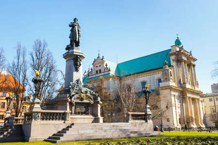 krakowskie przedmiescie: Adam Mickiewicz monument at Krakowskie Przedmiescie Street in Warsaw, Poland Stock Photo