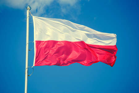 bandera de polonia: Polish flag on blue sky background, vintage look