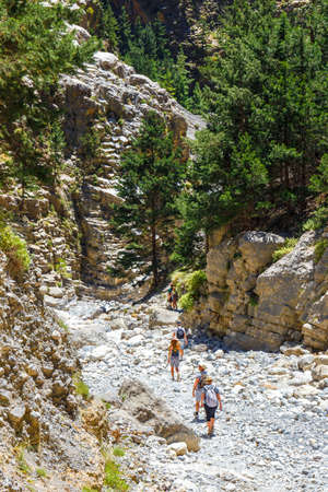 trecking: Tourists hike in Samaria Gorge in central Crete, Greece.