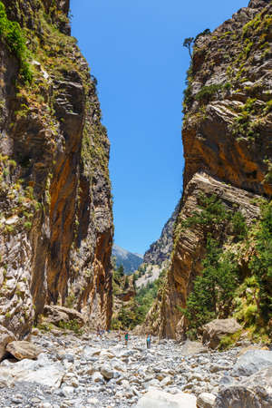 samaria: Samaria Gorge, Grece - MAY 26, 2016: Tourists hike in Samaria Gorge in central Crete, Greece. The national park is a UNESCO Biosphere Reserve since 1981 Stock Photo