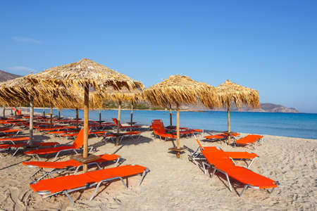 sun umbrellas: Sun umbrellas and chairs on beach
