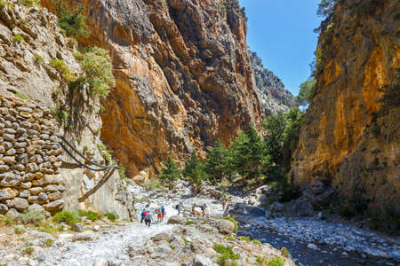 Tourists hike in Samaria Gorge in central Crete, Greece.