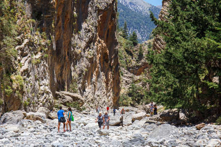 trecking: Samaria Gorge, Grece - MAY 26, 2016: Tourists hike in Samaria Gorge in central Crete, Greece. The national park is a UNESCO Biosphere Reserve since 1981 Editorial