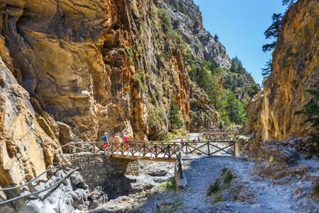 samaria: Samaria Gorge, Grece - MAY 26, 2016: Tourists hike in Samaria Gorge in central Crete, Greece. The national park is a UNESCO Biosphere Reserve since 1981 Editorial