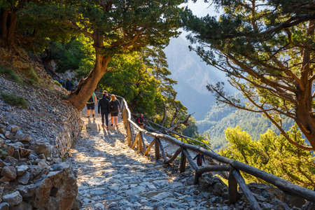 descend: Samaria Gorge, Grece - MAY 26, 2016: Tourists descend down the Gorge Samaria in central Crete, Greece. The national park is a UNESCO Biosphere Reserve since 1981