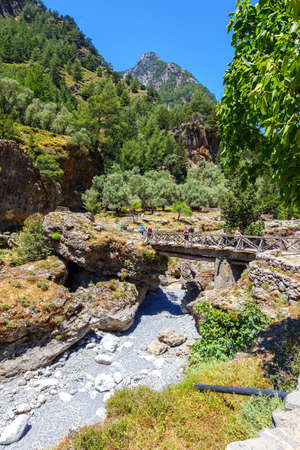 samaria: Samaria Gorge, Greece - MAY 26, 2016: Tourists hike in Samaria Gorge in central Crete, Greece. The national park is a UNESCO Biosphere Reserve since 1981