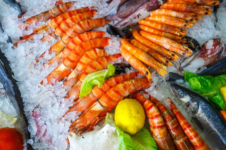 sparus: fresh seafood in the fridge of the seafood restaurant in Crete, Greece Stock Photo