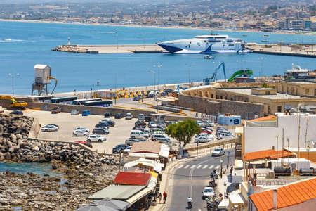 rethymno: Rethymno, Crete - 27 Maj, 2016 : Cityscape of the old venetian harbor in Rethymno, Greece