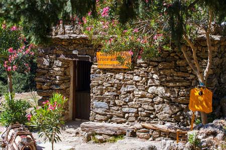passageway: Samaria Gorge, Greece - MAY 26, 2016: Tourists hike in Samaria Gorge in central Crete, Greece. The national park is a UNESCO Biosphere Reserve since 1981